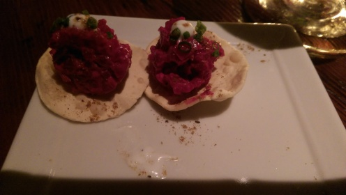 Beet spread on a crispy tortilla compliments of the chef